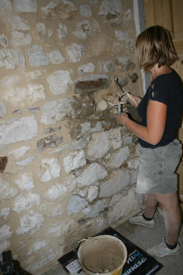 Rebuild stone walls in house restoration in Italy