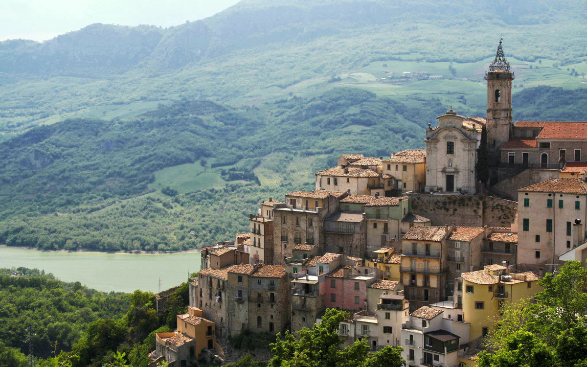 Colledimezzo, a hilltop town facing the lake and mountains in Abruzzo, Italy.