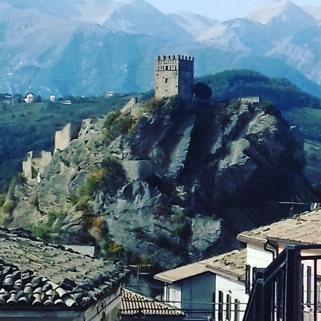 Medieval castle of Roccascalegna and mountains view