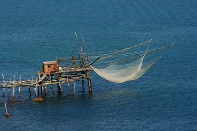 Fishing net is lowered from the Trabocco down to the sea