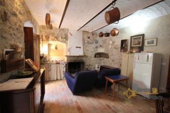 Completely restored stone house with small garden for sale.