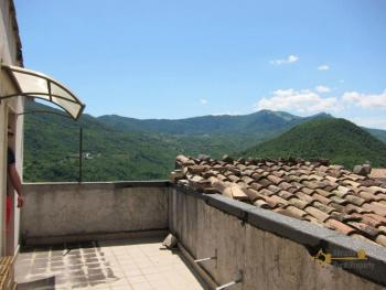 Traditional stone house with panoramic terrace for sale.