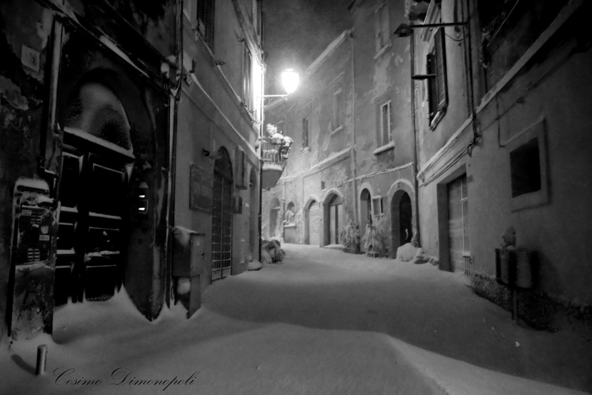 Ancient narrow streets under snow in Vasto, Italy