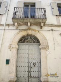 Large historic palazzo with garden and olive grove, for sale.